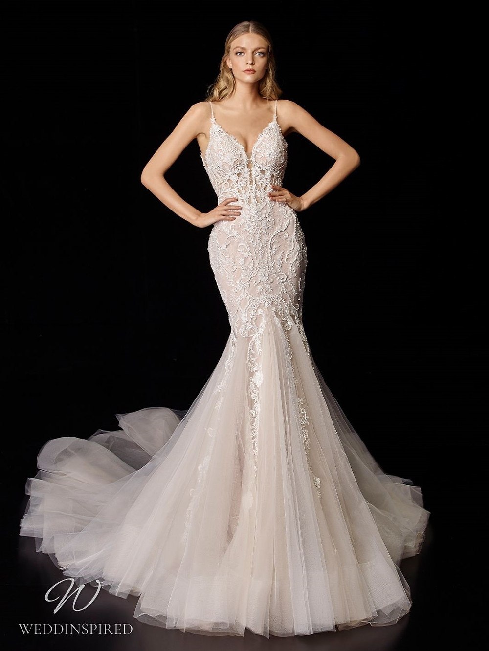 An Enzoani blush lace and tulle mermaid wedding dress with thin straps and a train