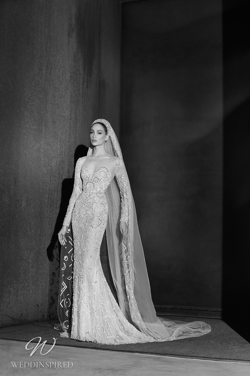 A Zuhair Murad Spring 2022 sparkly mesh mermaid wedding dress with long sleeves