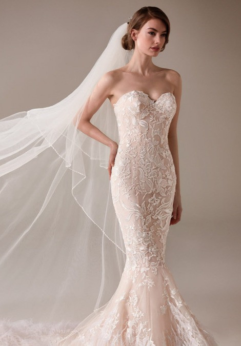 A blush mermaid wedding dress, with tulle skirt, lace and a sweetheart neckline