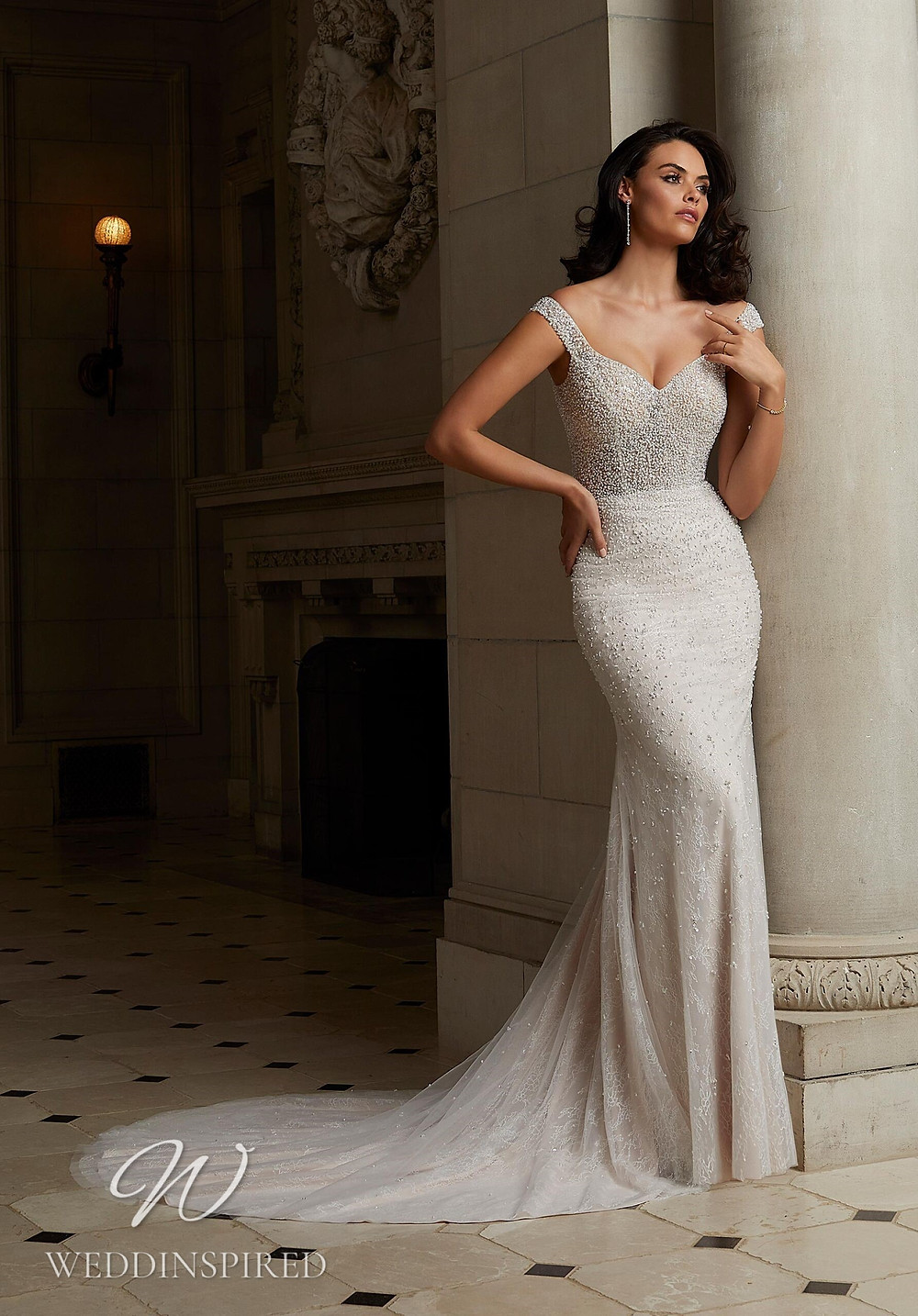A Madeline Gardner sparkly off the shoulder mermaid wedding dress
