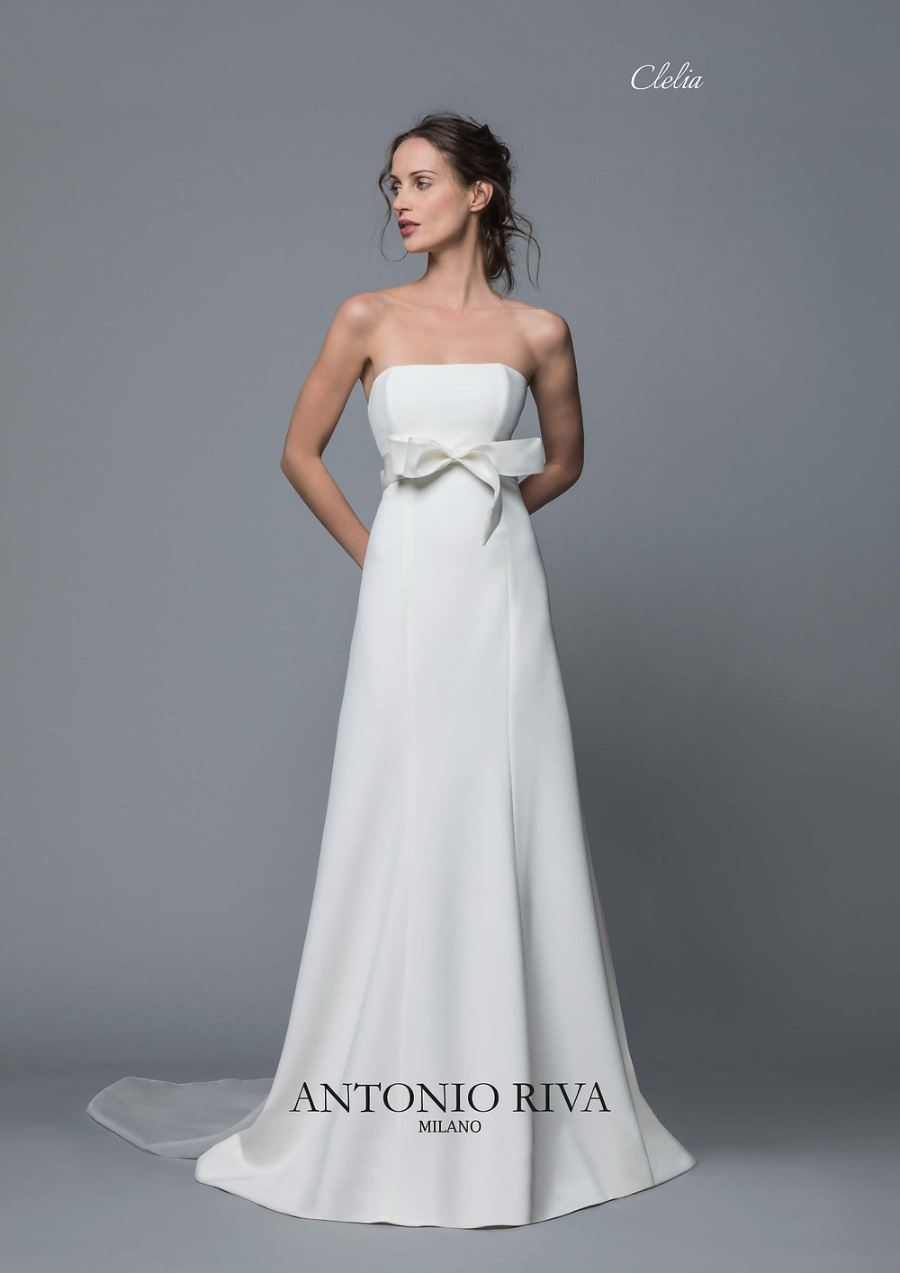 An Antonio Riva 2020 simple strapless crepe empire waist wedding dress with a bow