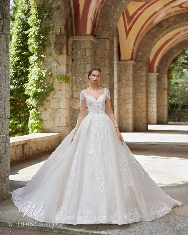 A Rosa Clara 2021 lace princess ball gown wedding dress with cap sleeves
