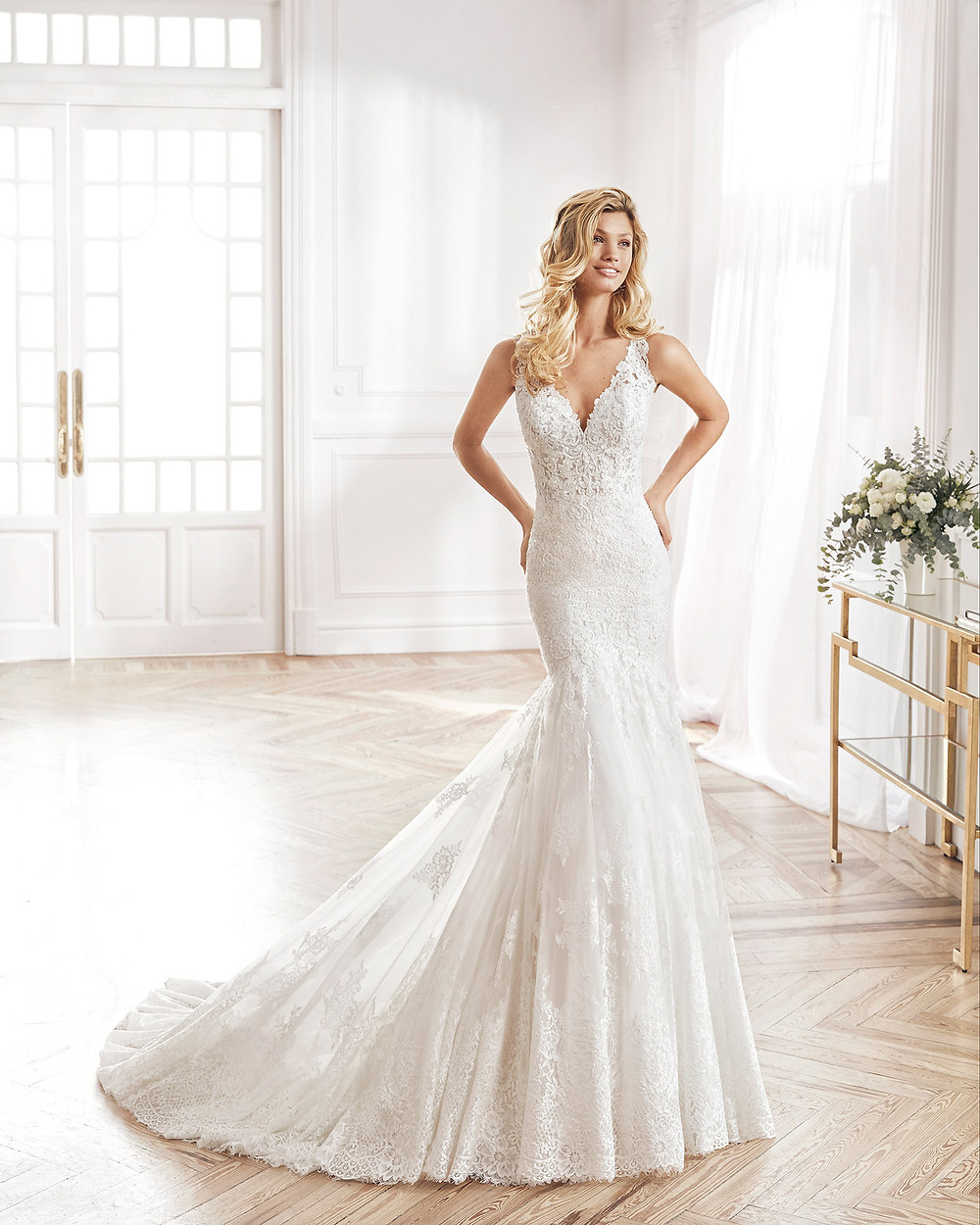 An Aire Barcelona 2020 lace mermaid wedding dress with straps and a v neckline