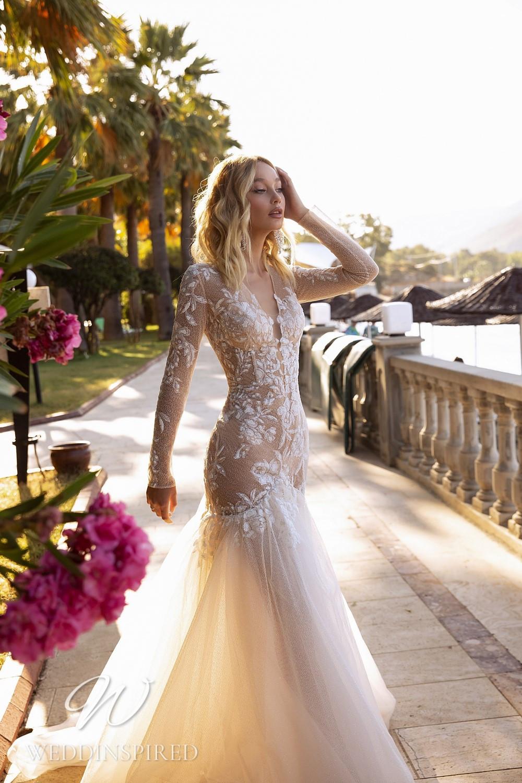 A Tina Valerdi blush lace mermaid wedding dress with long sleeves