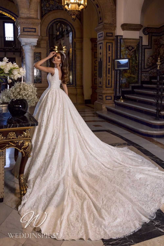 A Maks Mariano ivory lace princess wedding dress