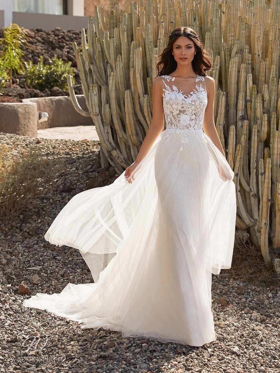 A Pronovias 2021 lace and tulle mermaid wedding dress with an illusion neckline