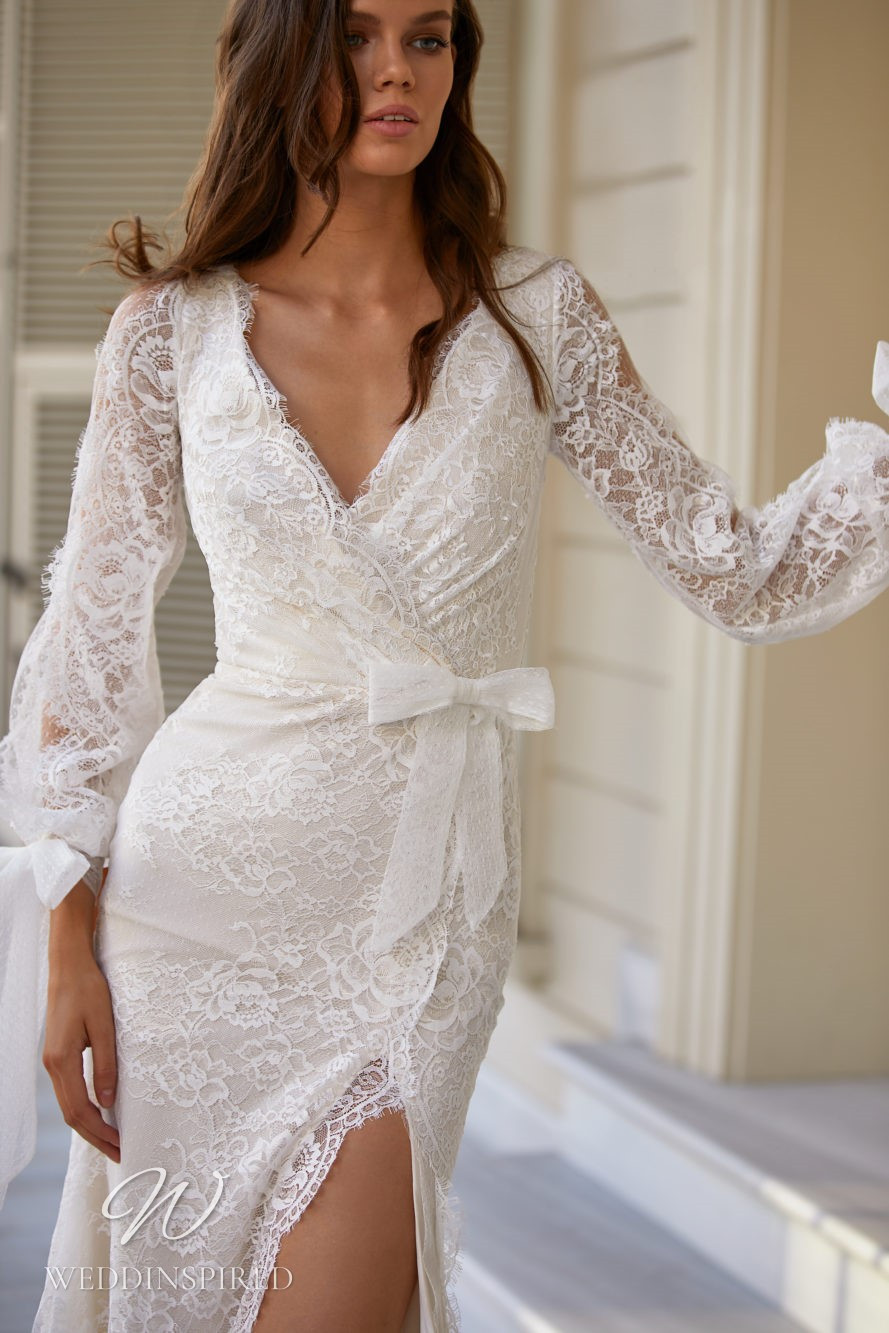 A Milla Nova 2021 lace mermaid wedding dress with long sleeves, a v neck and a slit