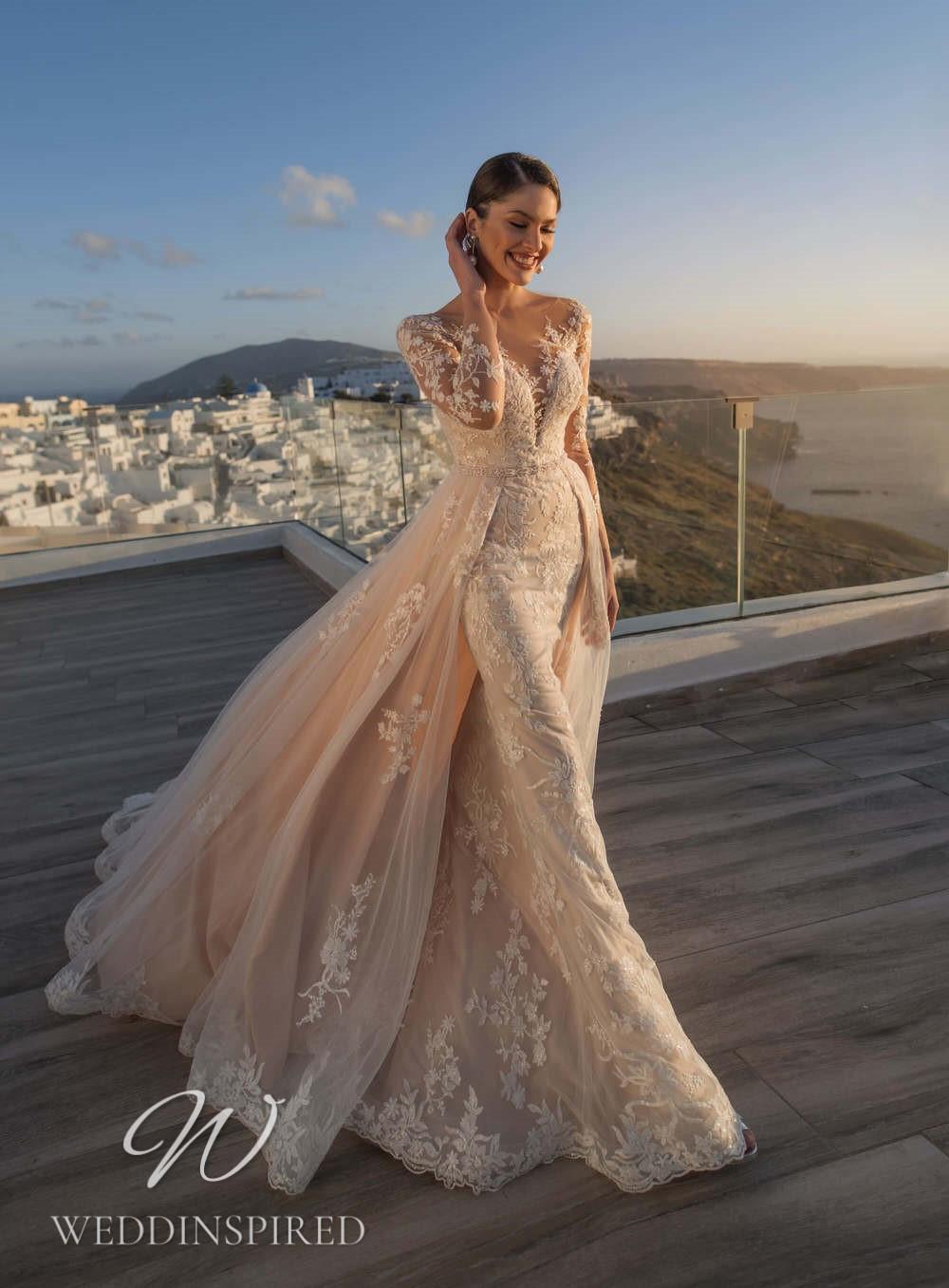 A Blunny 2021 blush lace mermaid wedding dress with a detachable skirt