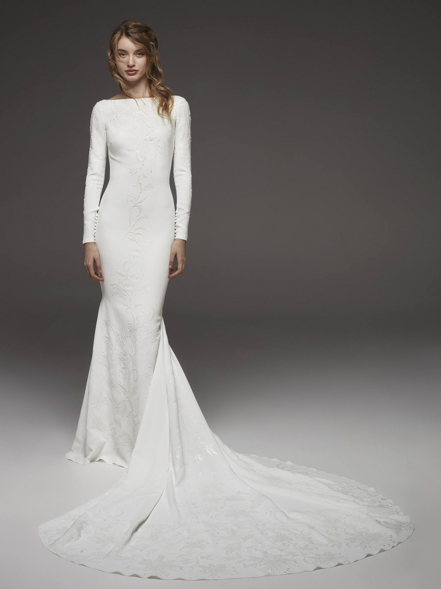 A Pronovias simple modest fitted wedding dress with long sleeves and a high neckline