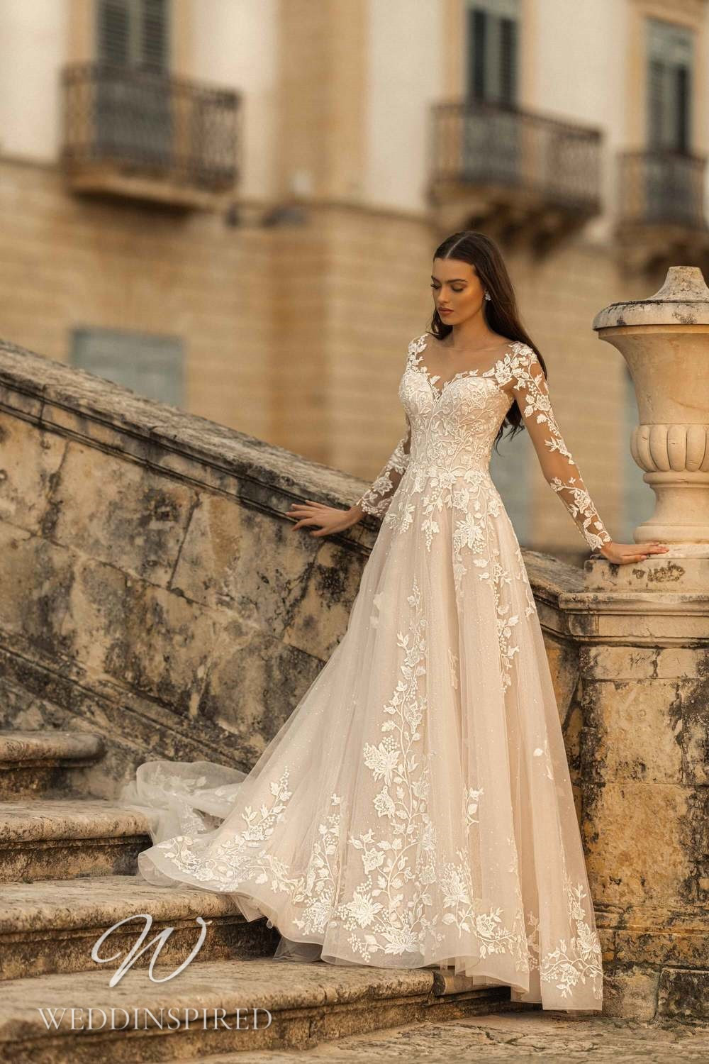 A Lussano 2021 blush lace and tulle A-line wedding dress with long sleeves