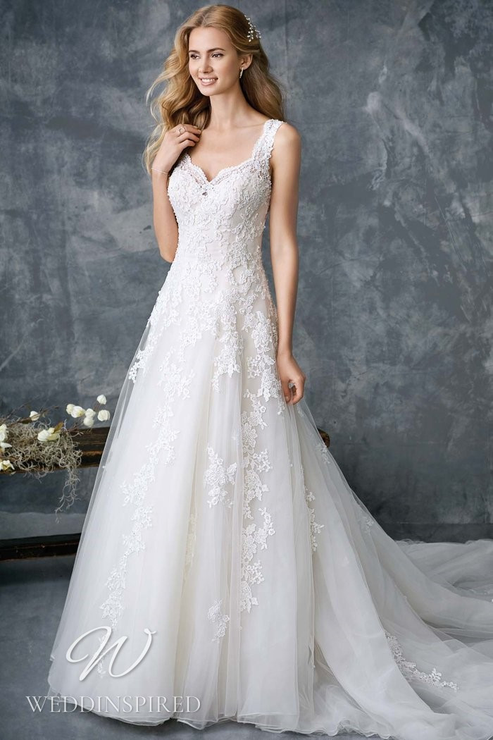 A Kenneth Winston 2021 lace and tulle A-line wedding dress