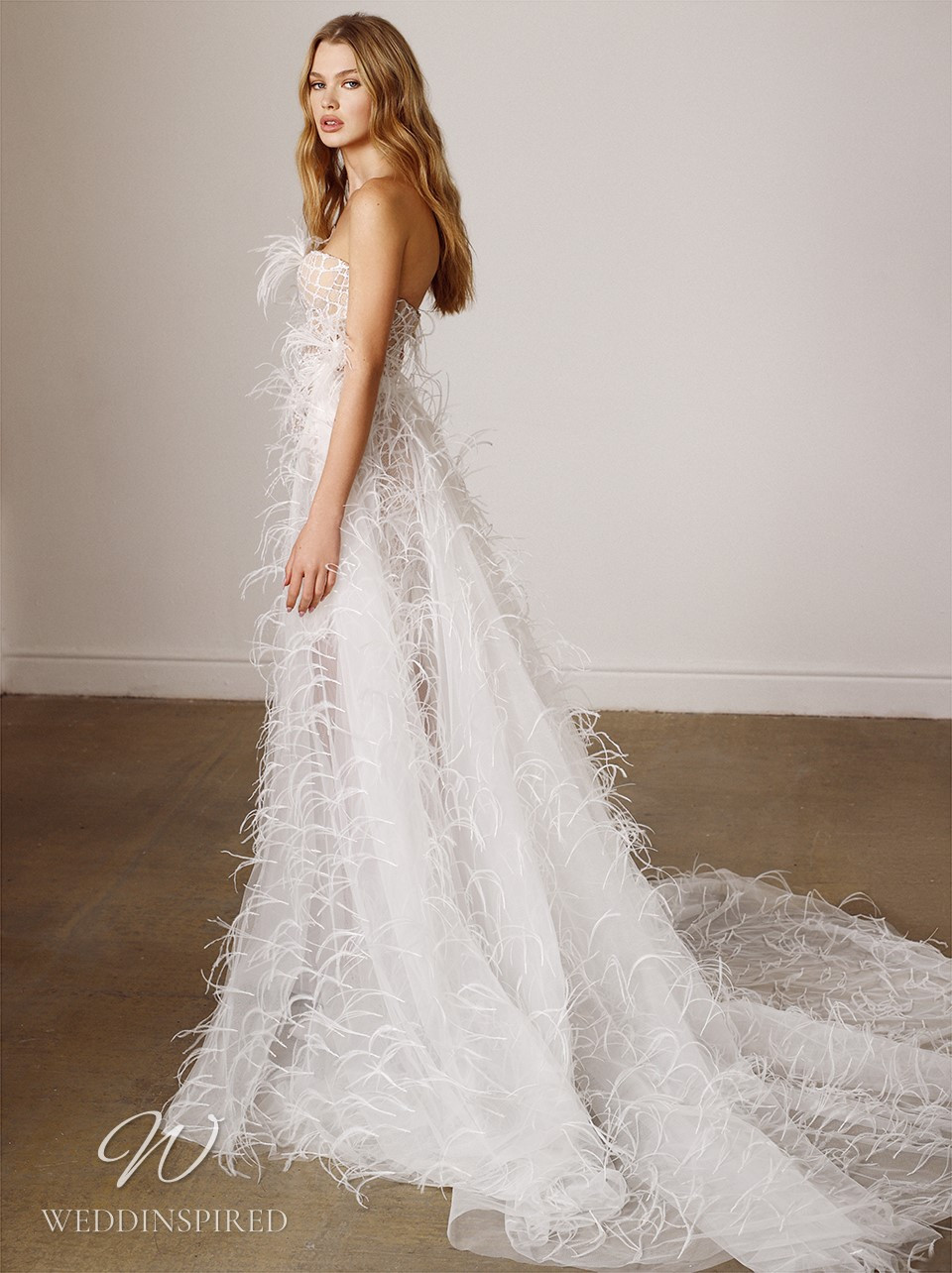 A Galia Lahav 2022 strapless nude short wedding dress with feathers, fringe and a detachable skirt