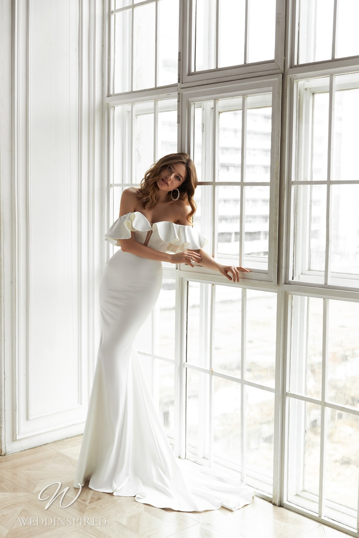 An Eva Lendel 2021 simple off the shoulder silk mermaid wedding dress with a ruffle neckline