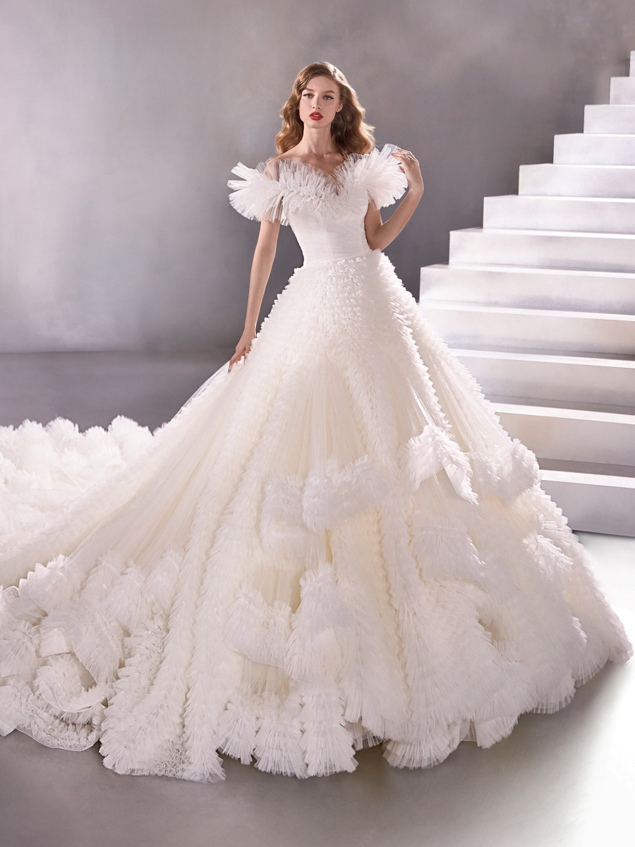 A Pronovias off the shoulder tulle ball gown wedding dress with a layered skirt