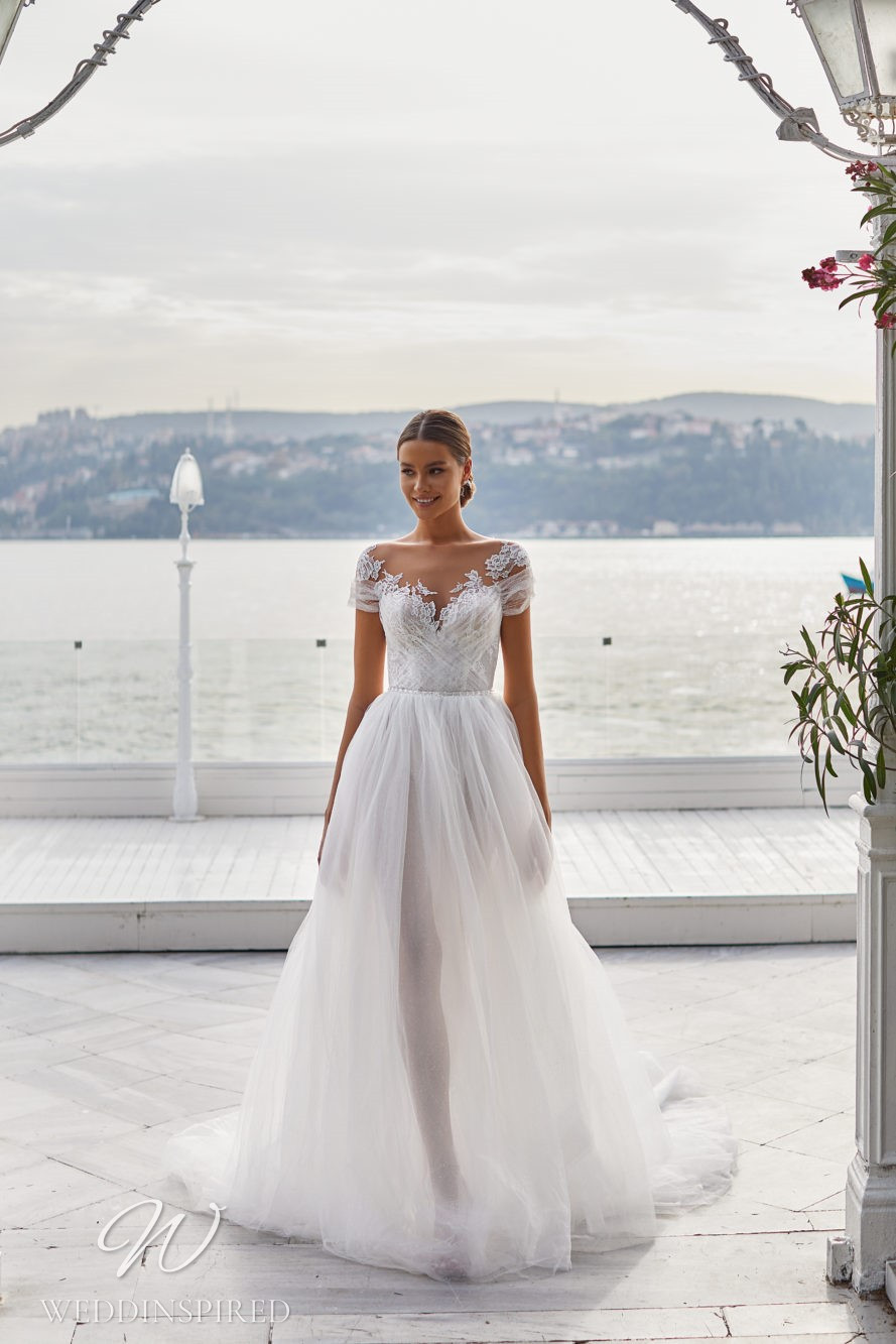 A Milla Nova 2021 lace and tulle off the shoulder A-line wedding dress