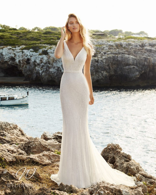 An Aire Barcelona 2021 sparkly mermaid wedding dress with a v neck