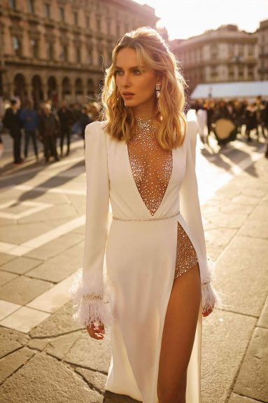 A Berta sparkly sexy fitted wedding dress with a high slit and long sleeves