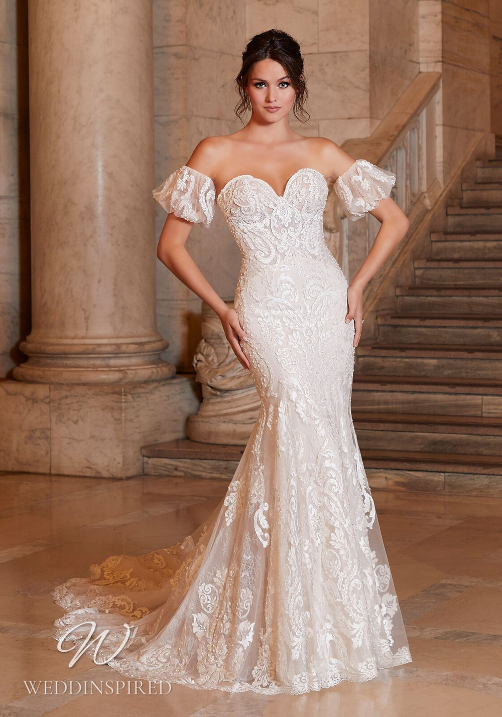 A Madeline Gardner strapless lace mermaid wedding dress