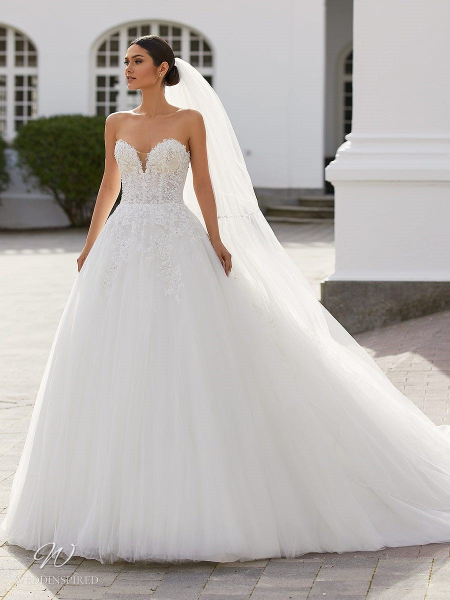 A Pronovias 2021 strapless lace and tulle ball gown wedding dress