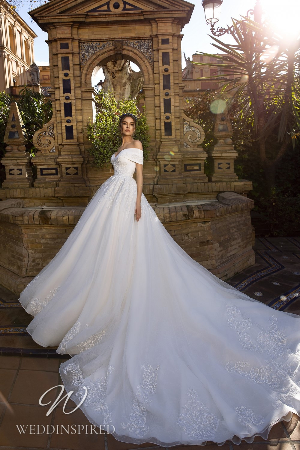 A Maks Mariano off the shoulder tulle princess wedding dress