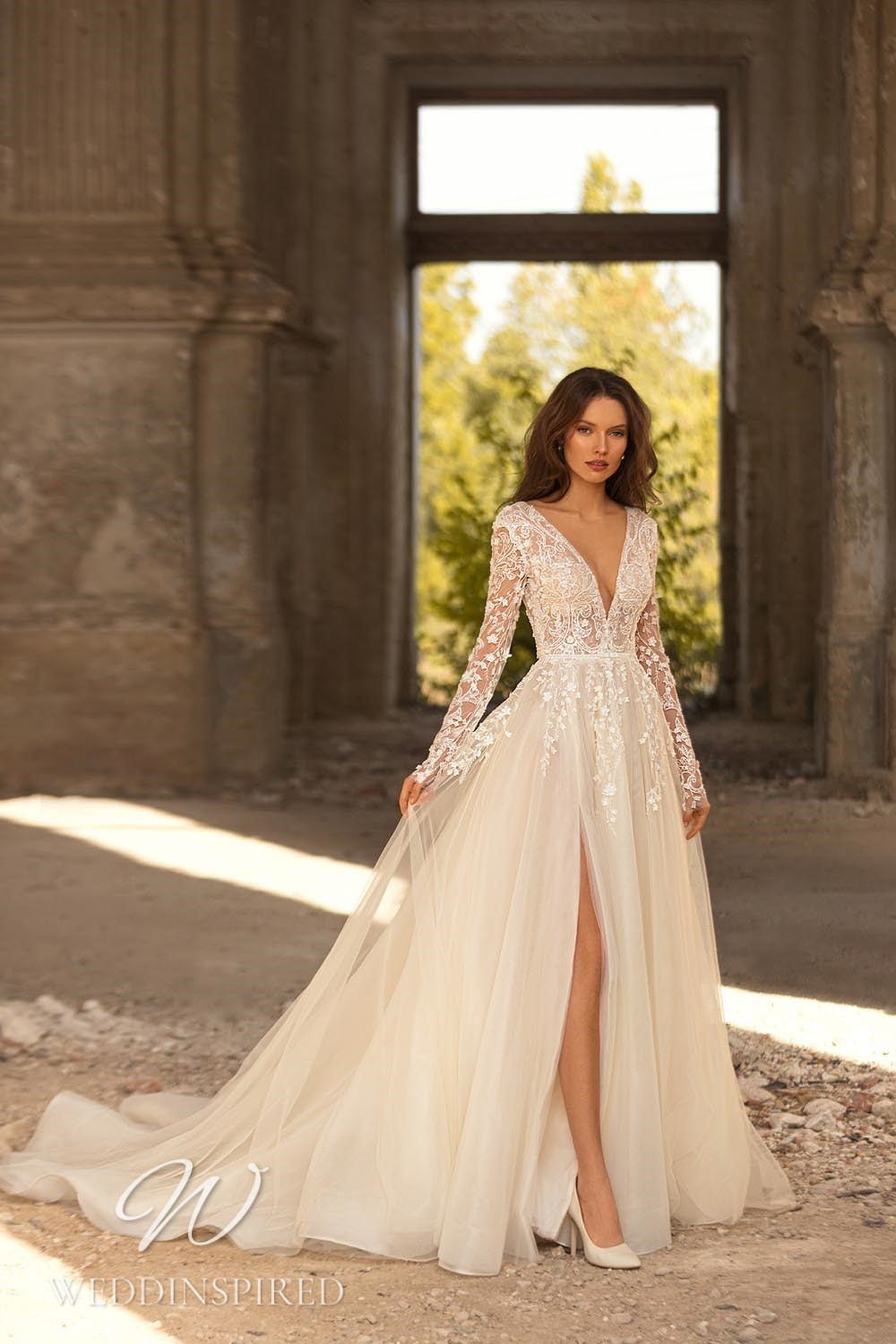 An Eva Lendel 2021 lace and tulle A-line wedding dress with long sleeves