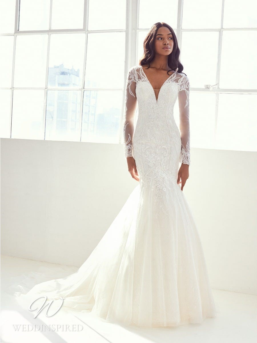 An Ashley Graham x Pronovias 2021 lace and tulle mermaid wedding dress with long sleeves and a v neck