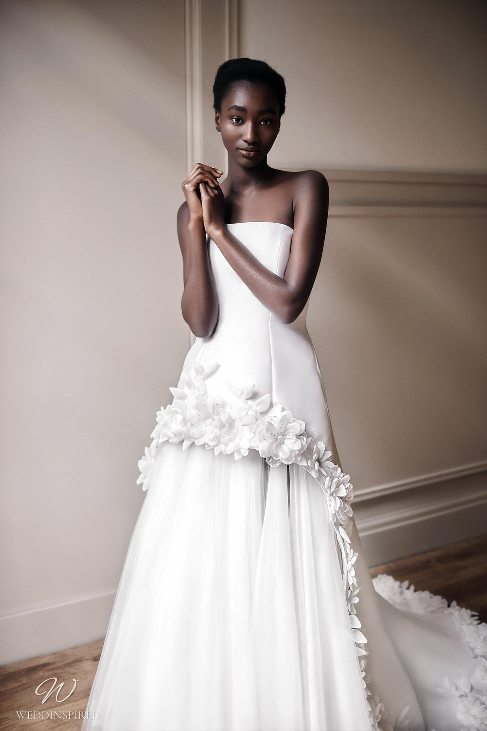 A Viktor & Rolf 2021 strapless princess ball gown wedding dress with a tulle skirt and  flowers