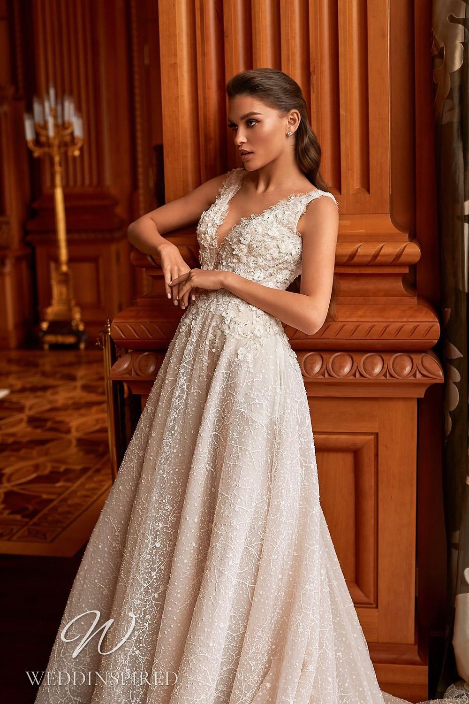A Pollardi 2021 lace A-line wedding dress with a v neck