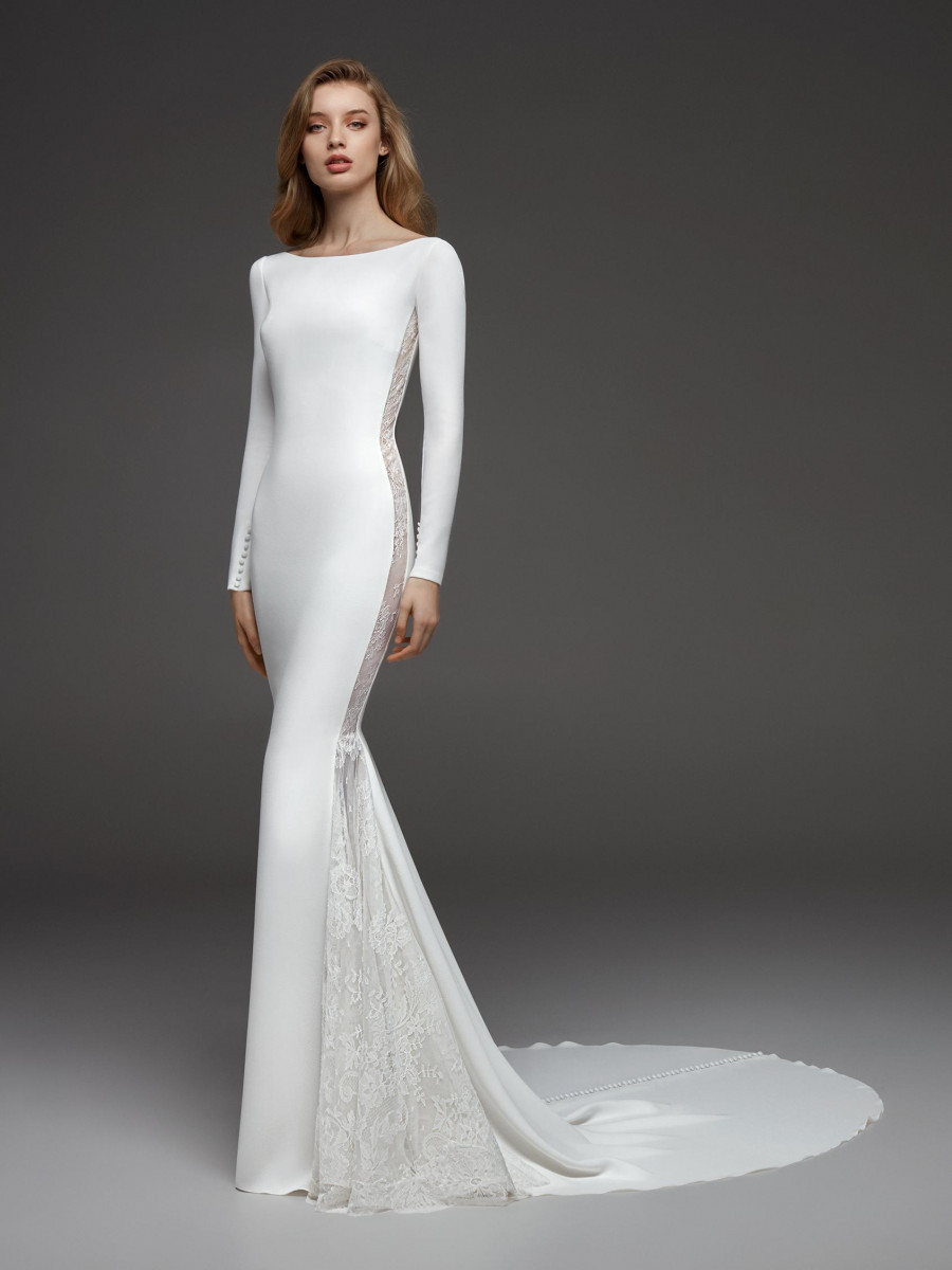 A Pronovias simple modest mermaid wedding dress with long sleeves and lace inserts