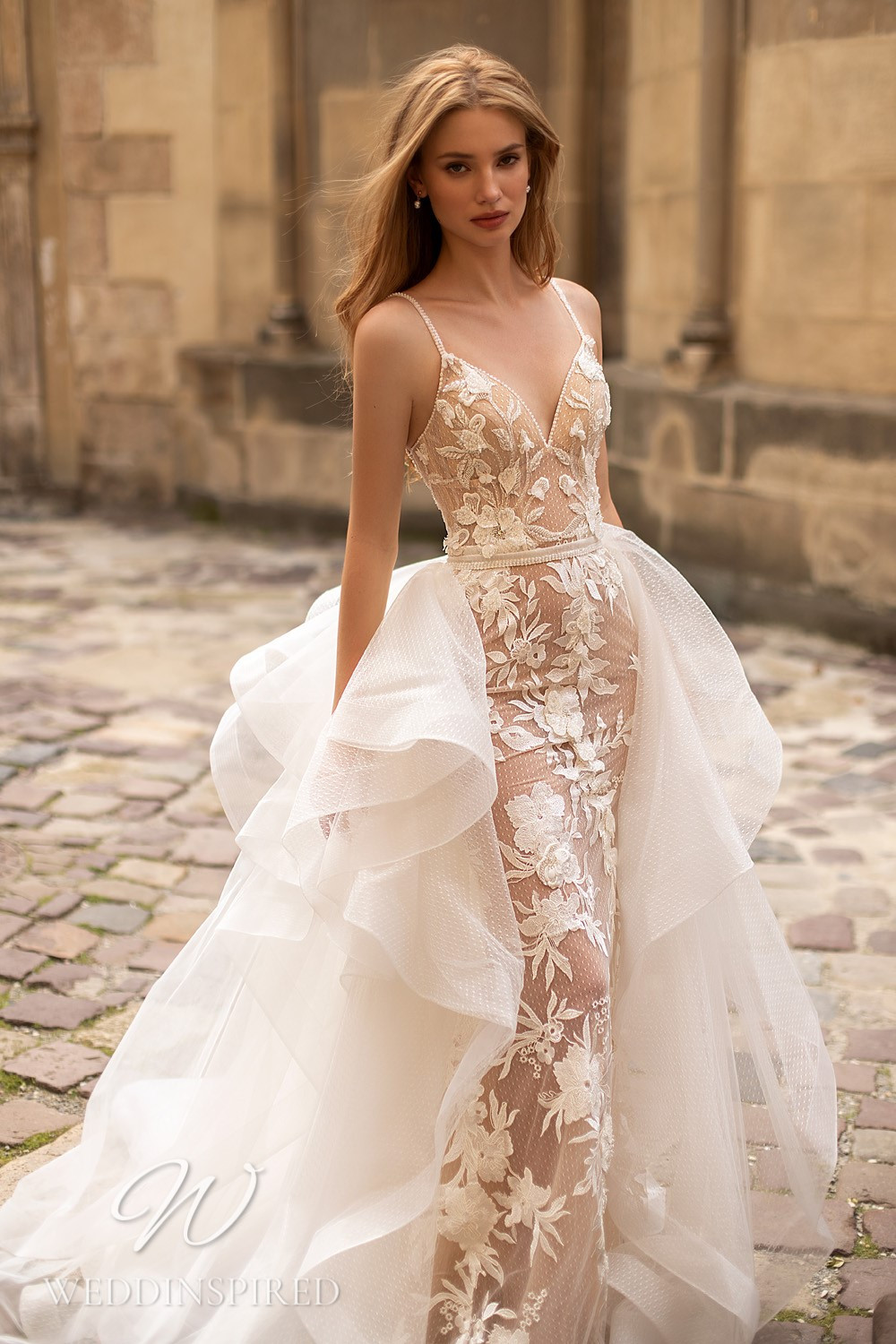 A WONÁ Concept 2021 tulle and lace mermaid wedding dress with a detachable skirt