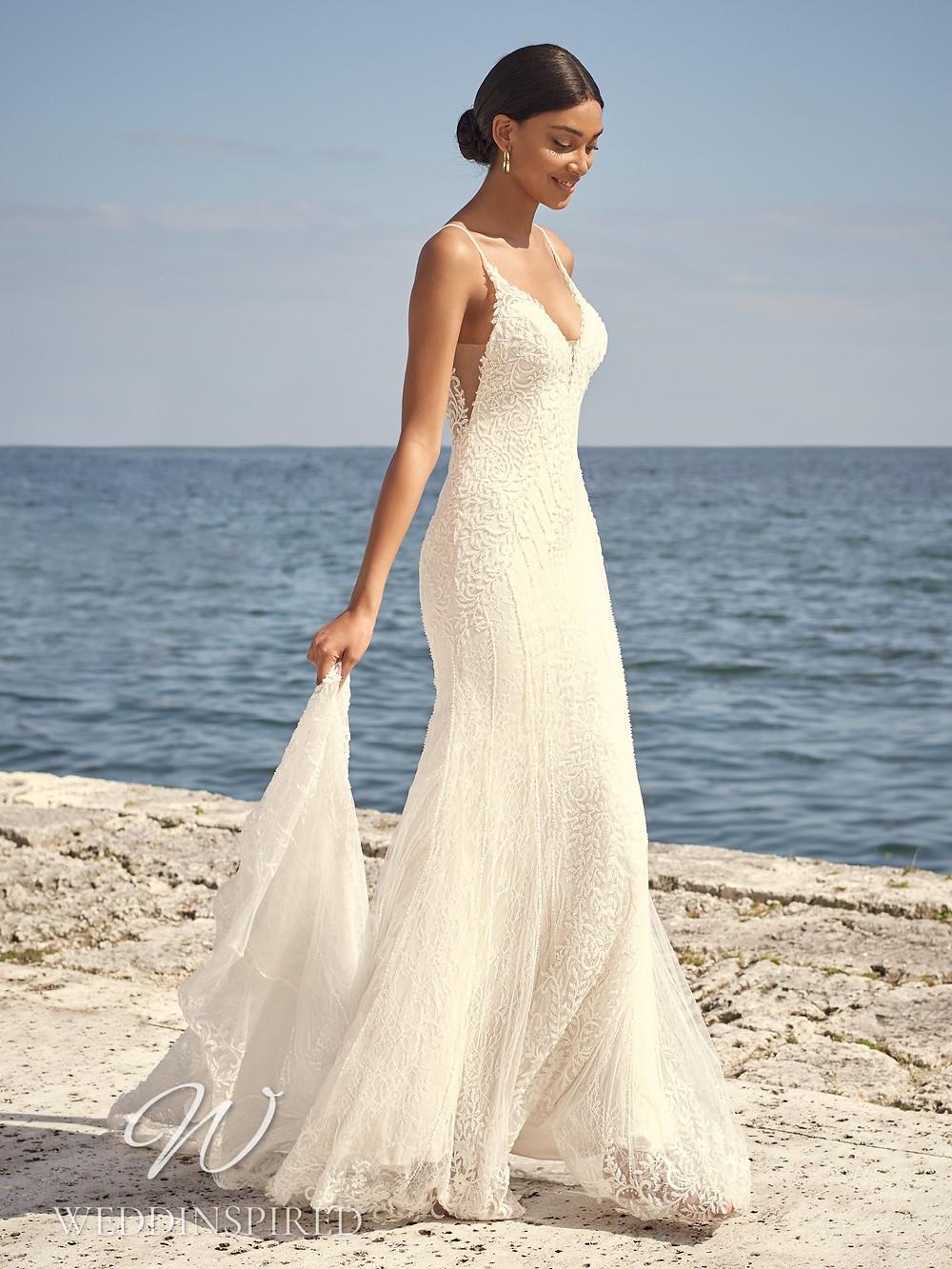 A Sottero & Midgley 2021 lace mermaid wedding dress with a v neck