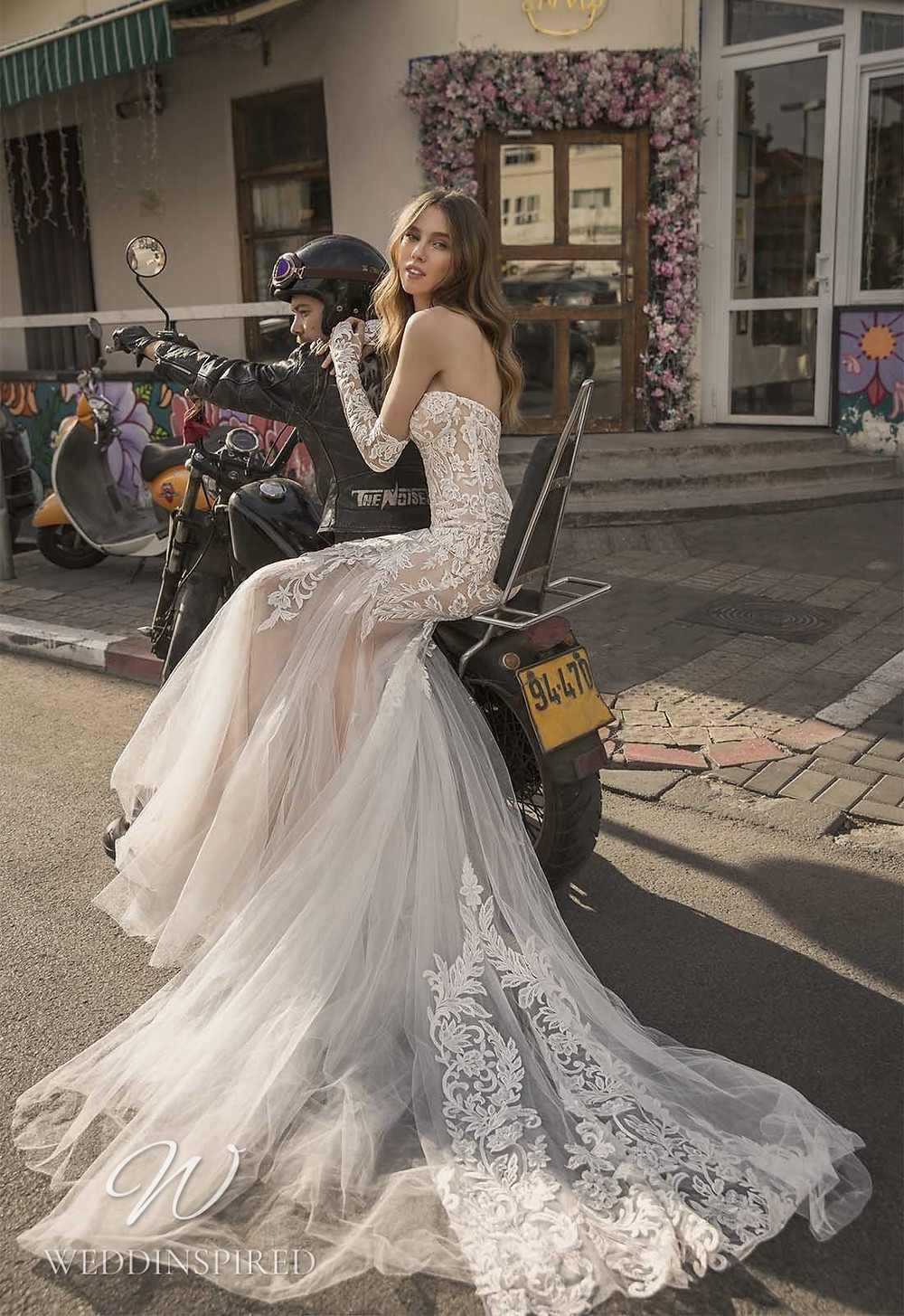 A Pnina Tornai 2021 strapless lace and tulle mermaid wedding dress