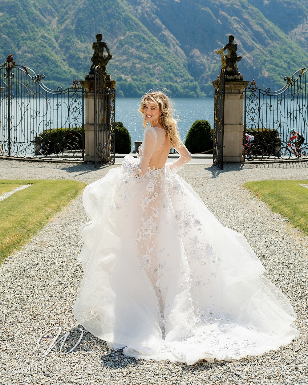 A Berta 2022 tulle and lace A-line wedding dress with long sleeves