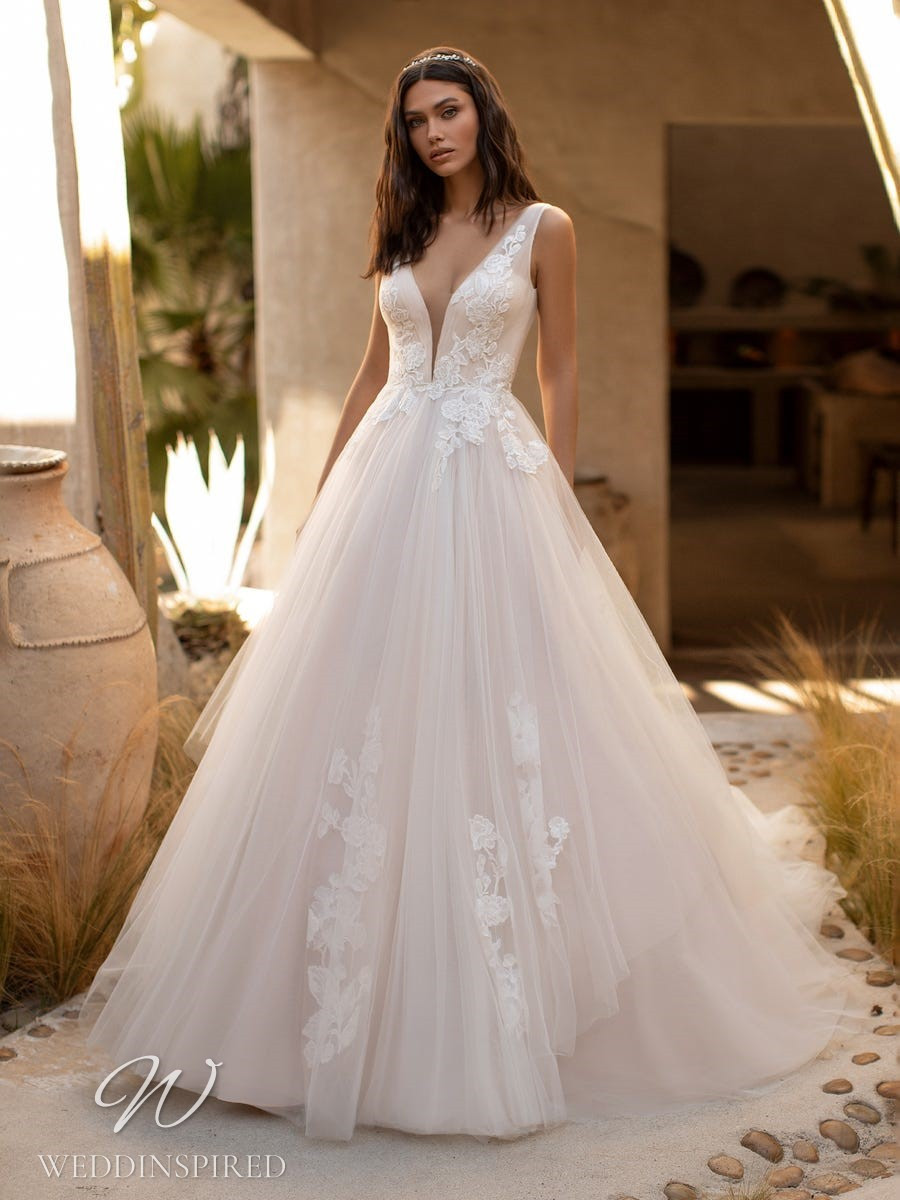 A Pronovias 2021 blush tulle ball gown wedding dress with straps and a v neck