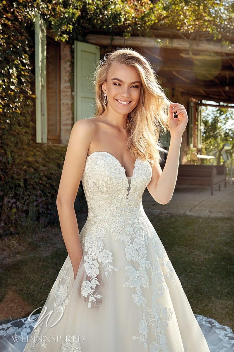 An Eddy K 2021 strapless lace A-line wedding dress with pockets