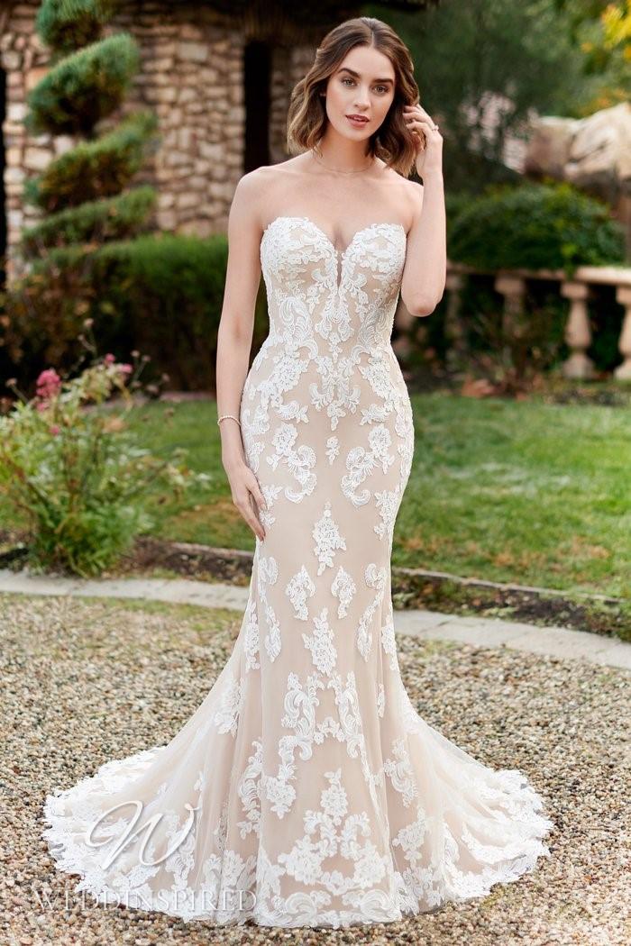 A Kenneth Winston 2021 blush lace mermaid wedding dress