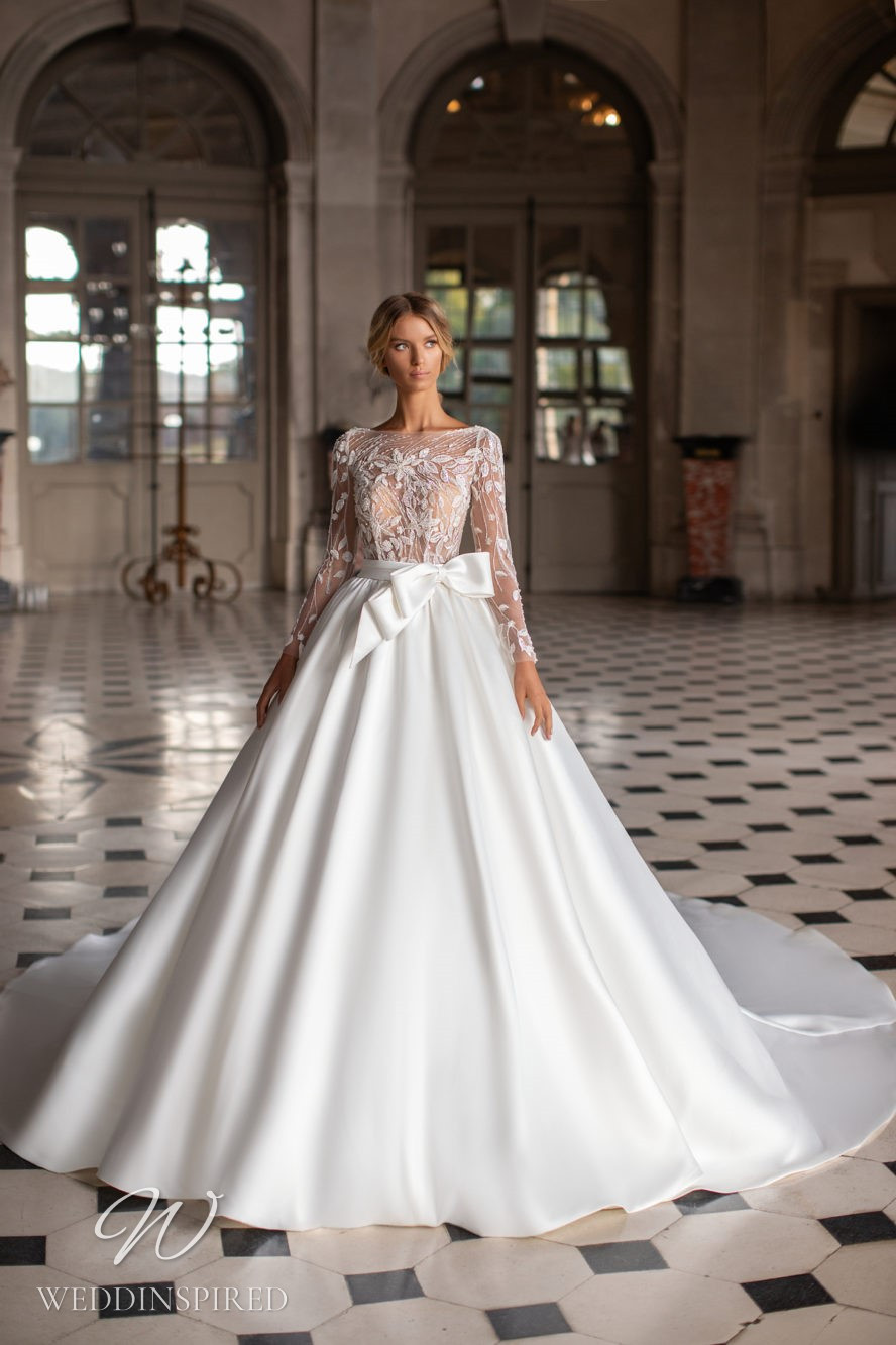 A Milla Nova princess ball gown wedding dress with a detachable skirt and lace
