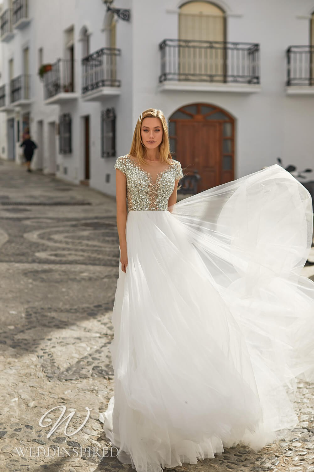 An Essential by Lussano 2021 sparkly tulle A-line wedding dress with cap sleeves