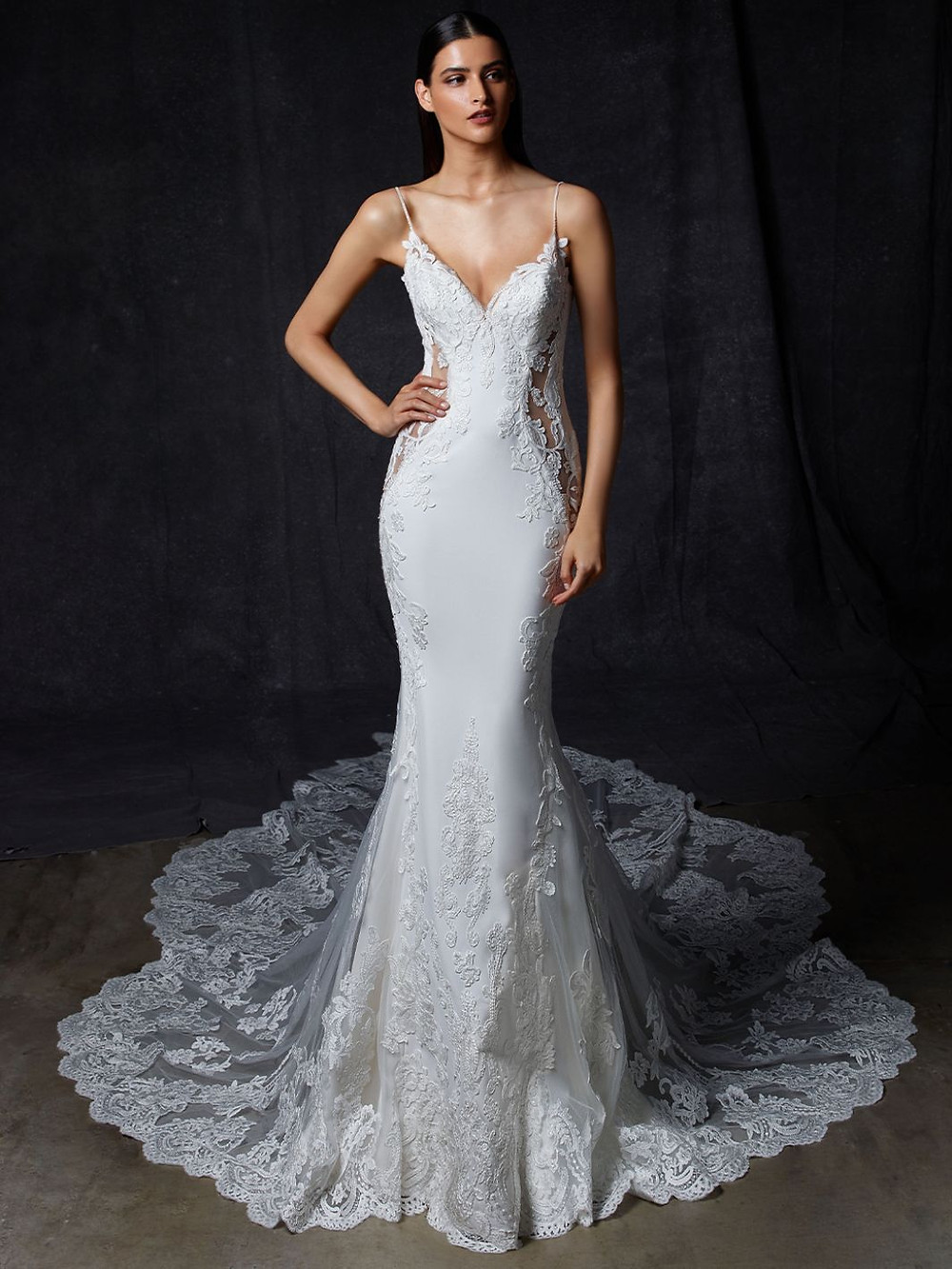 An Enzoani silk and lace mermaid wedding dress with thin straps and a long veil