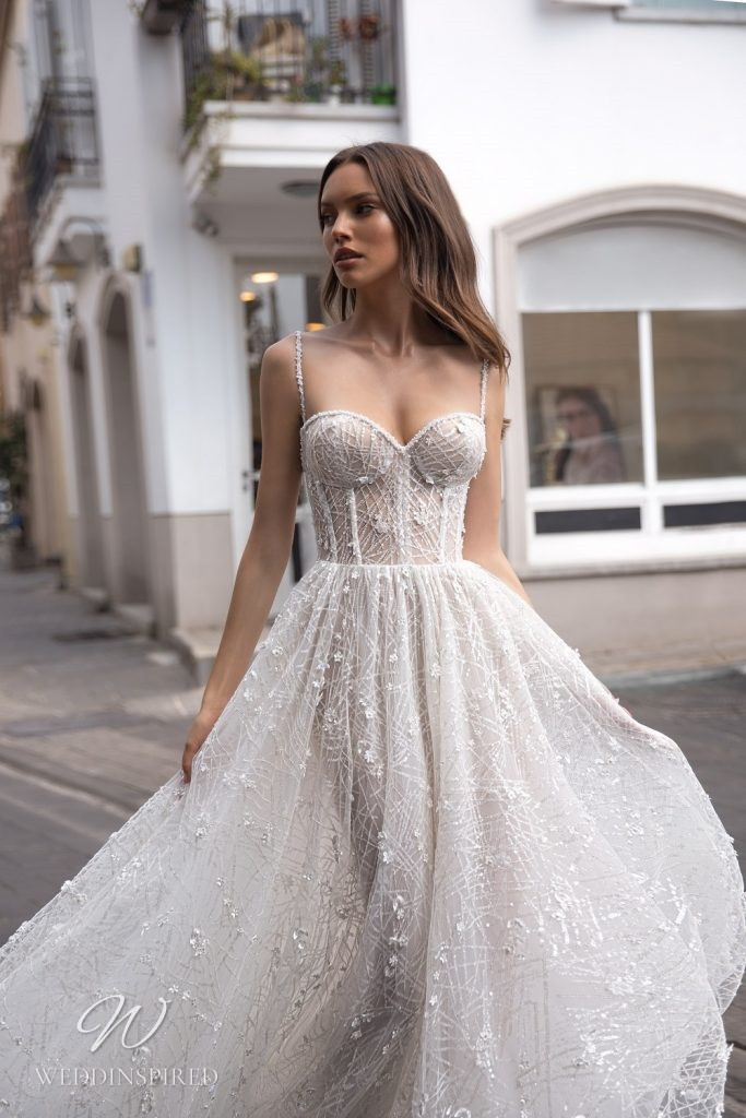 An Eden Aharon 2020 lace and tulle A-line wedding dress with a bustier top and straps