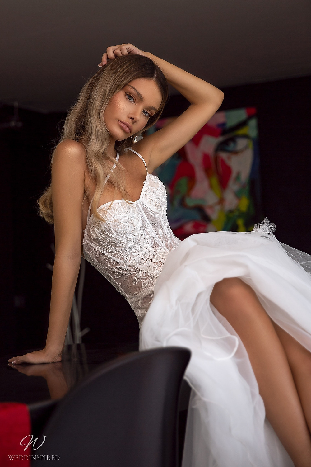 A Tina Valerdi lace and tulle A-line wedding dress with a sweetheart neckline