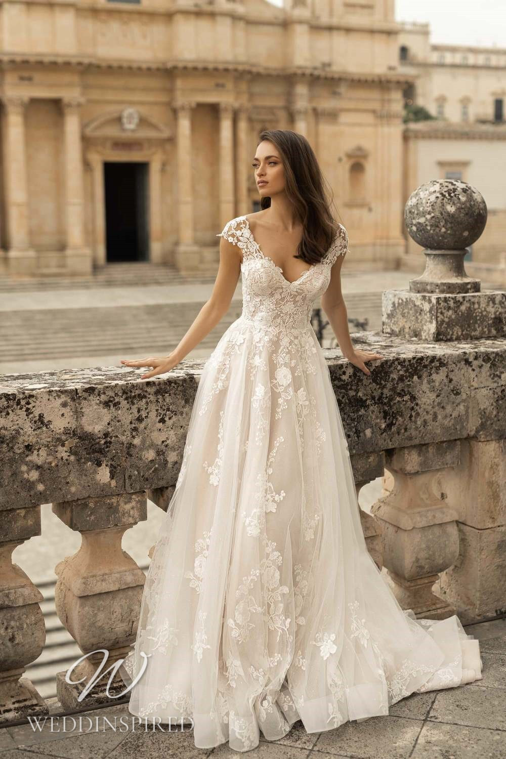 A Lussano 2021 lace and tulle A-line wedding dress with a v neck