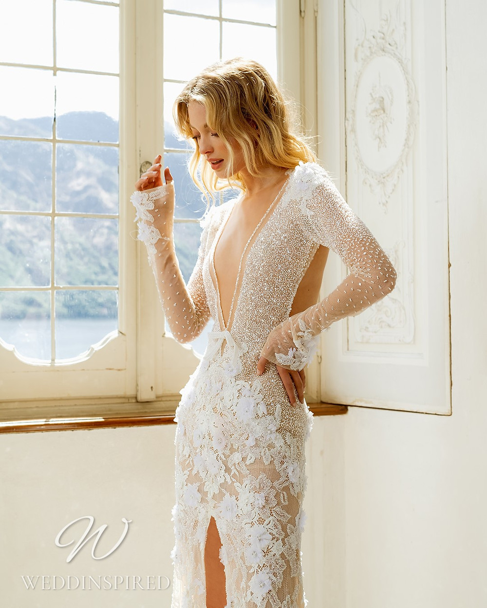 A Berta 2022 flowy tulle and lace boho A-line wedding dress with long sleeves