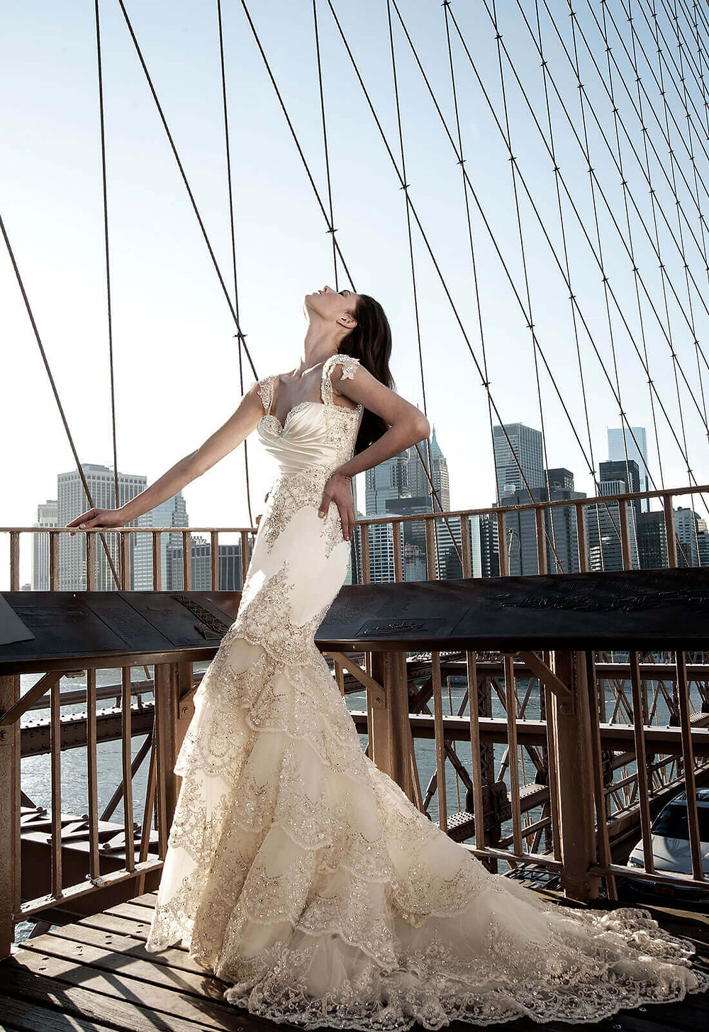 A satin, champagne mermaid wedding dress with lace and straps