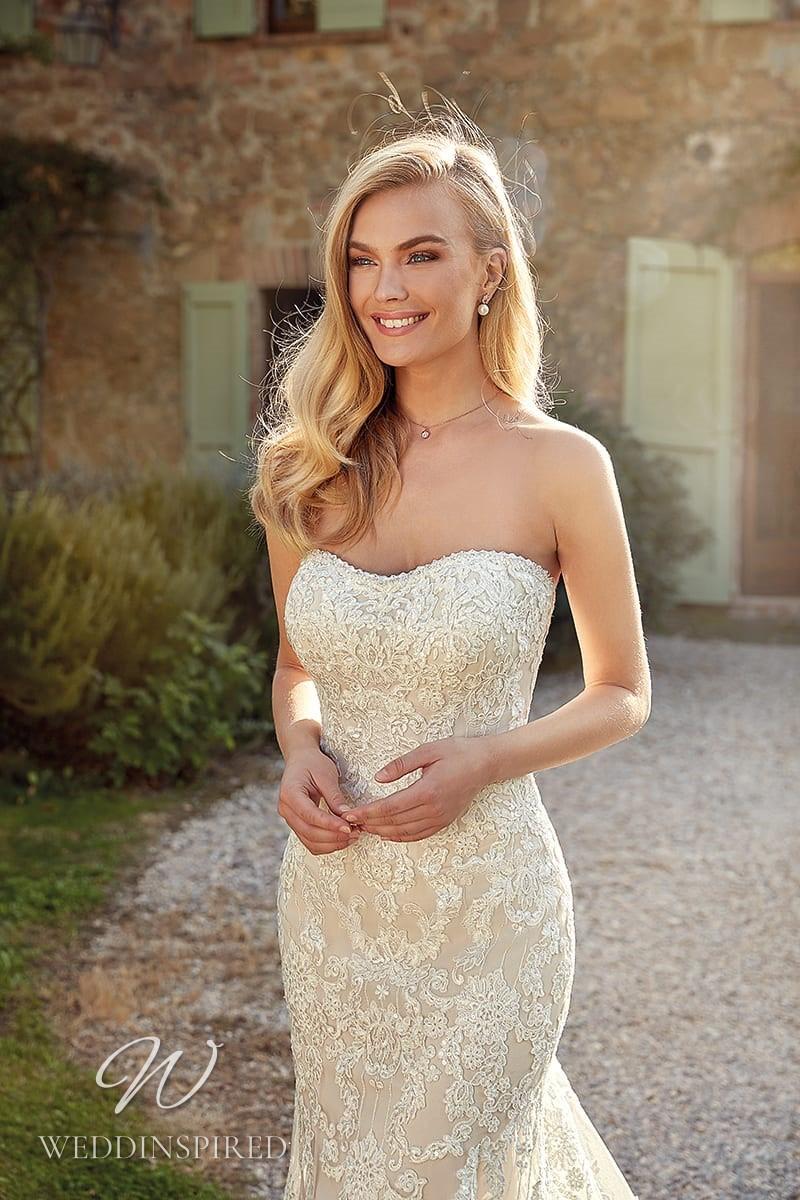 An Eddy K 2021 ivory strapless lace mermaid wedding dress