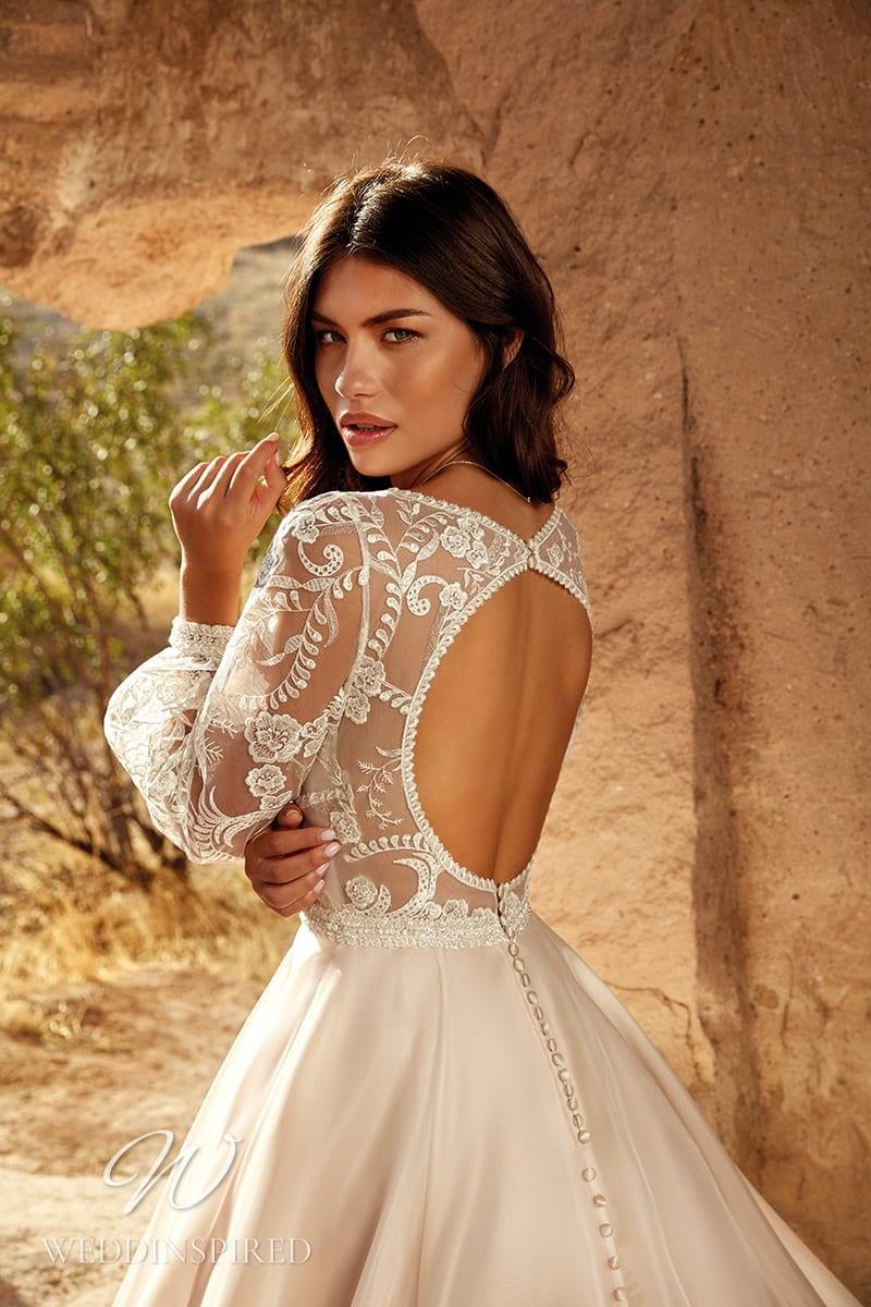 An Eddy K 2021 lace and satin A-line wedding dress with a keyhole back