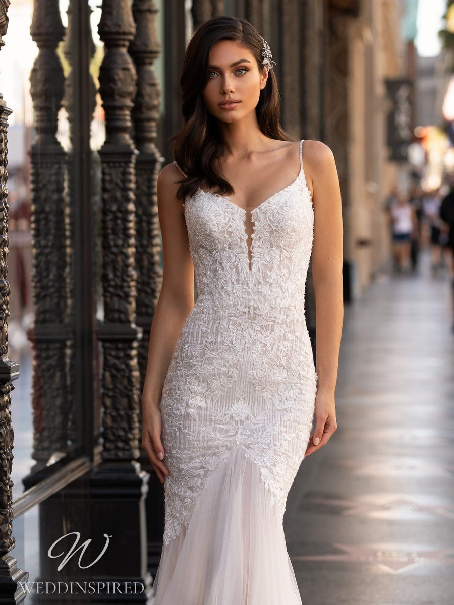 A Pronovias 2021 lace and tulle mermaid wedding dress with straps