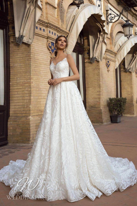 A Maks Mariano strapless lace princess wedding dress