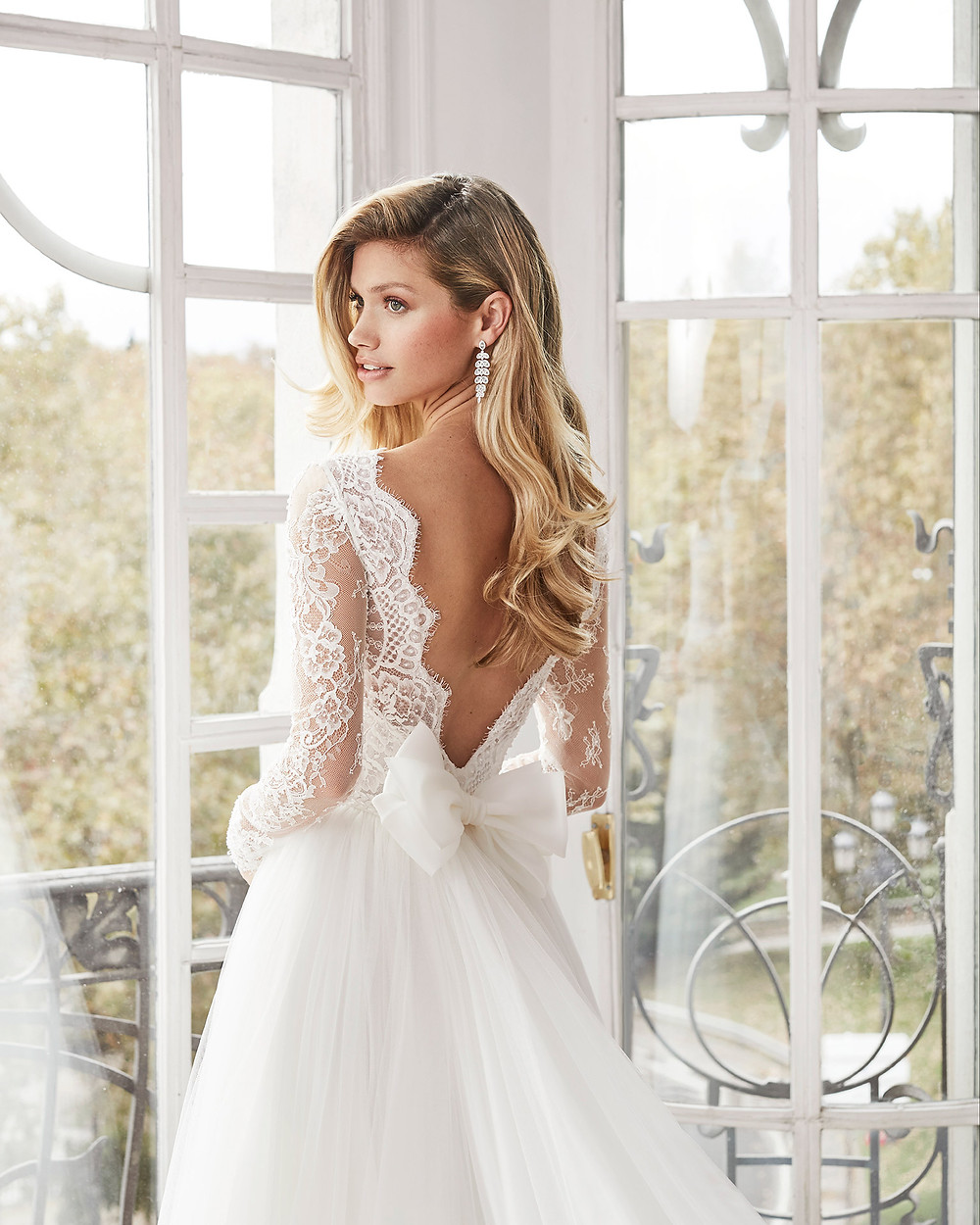 An Aire Barcelona 2020 lace and tulle A-line wedding dress with long sleeves and a low back