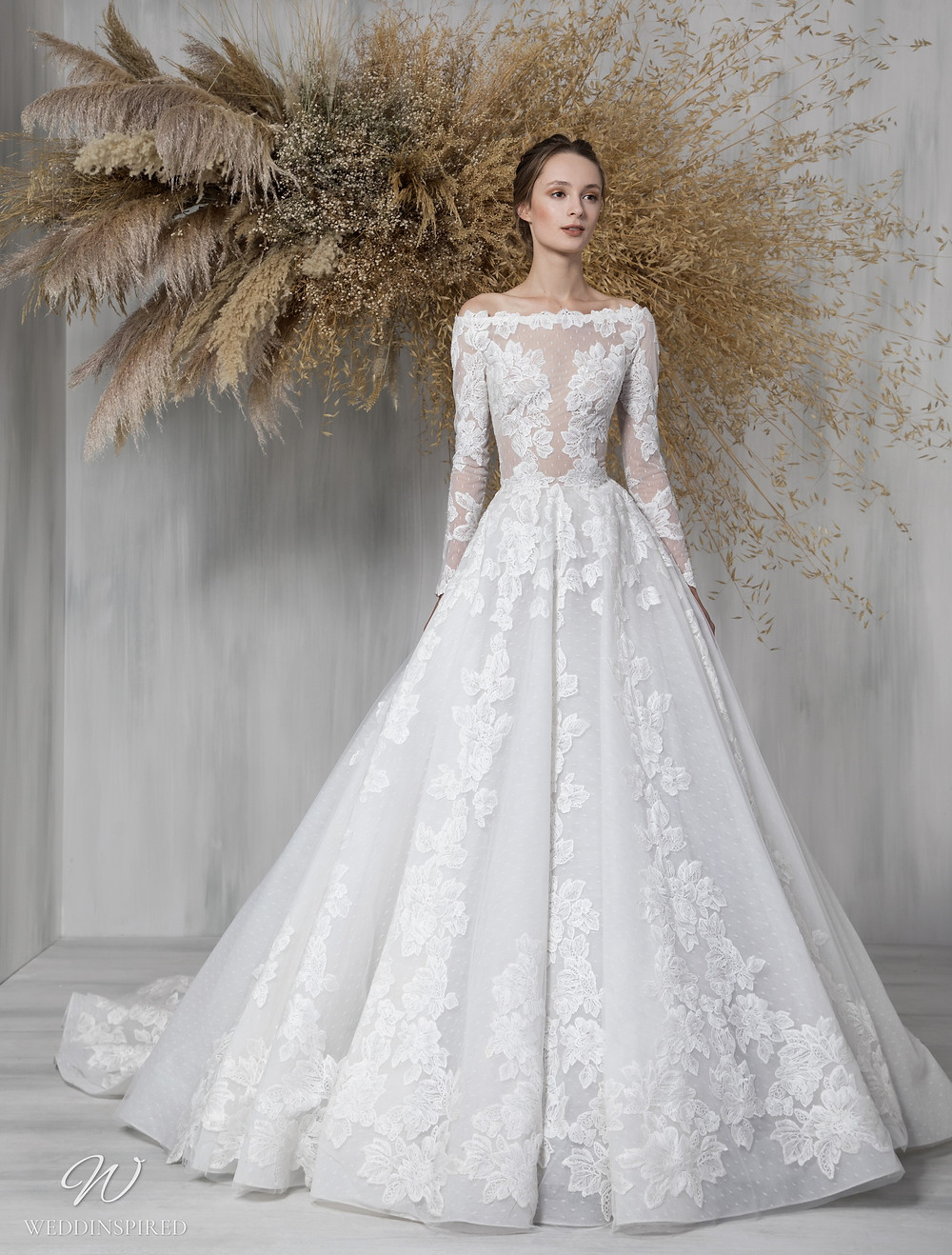 A Tony Ward 2021 lace and mesh ball gown wedding dress with long sleeves and an illusion bodice